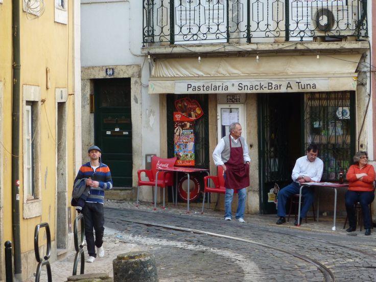 men outside pastelaria lisbon