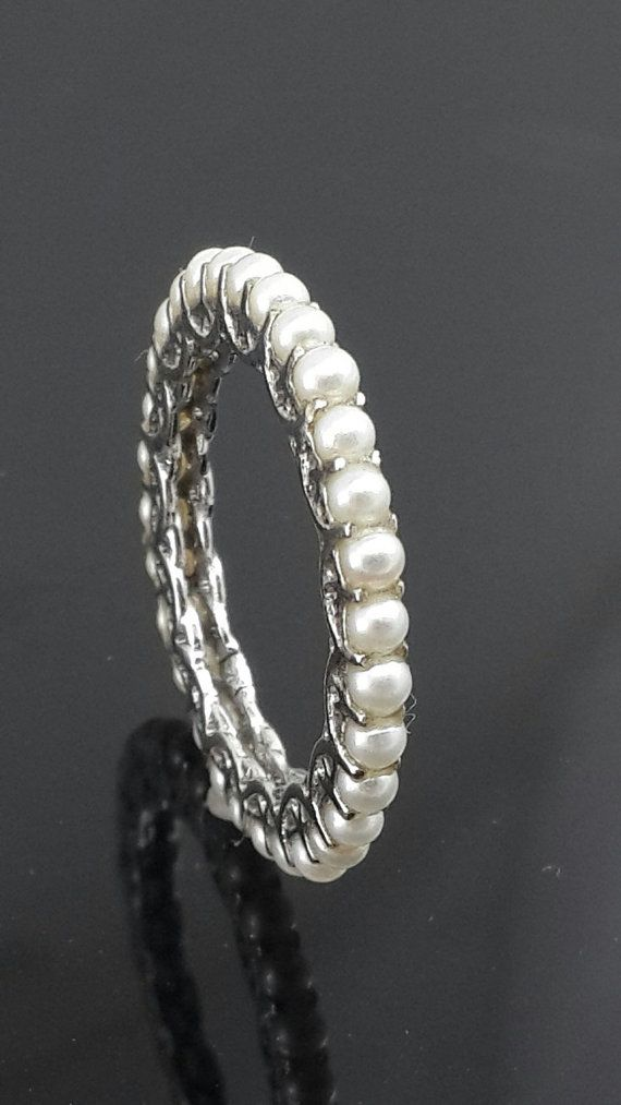 . 9ct white gold . eternity ring . Wt.1.90 . Width.2.08 . Thickness. 3.60 . Natural freshwater pearls . slim line band . all sizes available .