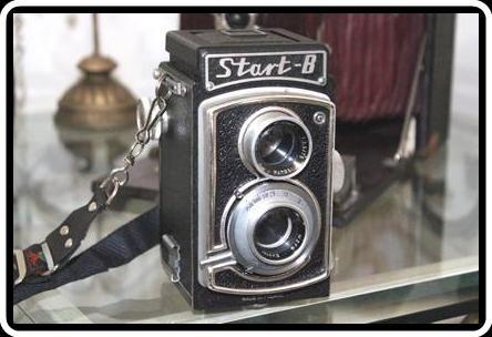 """START B fabricada na Polônia entre 1960 e 1967.  Tem a lente EUKTAR.    A""""Start B"""" foi um sucesso. Era oferecida com o nome de """"Noco flex"""", no mercado americano e """"Universa Uniflex 66"""", no mercado alemão."""