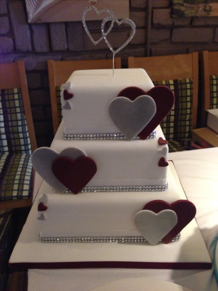 This burgundy and silver square wedding cake with hearts is so sweet! I would just change the topper to an 'H' or the b&g in jeep idea; as eel as put silver beads where the rhinestones are.