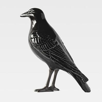 The Naughty Crow (Black Legs): A faience piece, glazed and decorated according the tradition of using the manual technique of dipping and painting on glass and enhanced by two claws cast in oxidised brass, according to the manual process of casting in a sand mould, and oxidised finish.