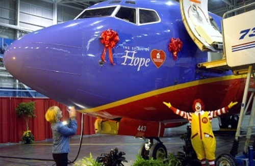 Southwests Spirit of Hope Boeing 737: Just like Asiana, Southwest stays minimal with their charity logos. In this case, for the Spirit of Hope 737 painted up in 2004, SWA celebrates the 30th anniversary of Ronald McDonald House. Believe it or not, the Ronald McDonald House program is the primary corporate charity of Southwest Airlines, with golf tournaments and everything. perrin22 faeweiler
