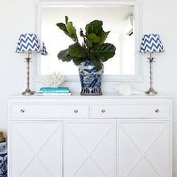 Adore Magazine - entrances/foyers - white foyer, foyer, foyer design, white mirror, foyer mirror, white foyer mirror, white baroque mirror, baroque mirror, faux bamboo lamps, silver bamboo lamps, chevron lamp shades, white and blue chevron lamp shades, blue chevron lamp shades, bamboo cabinet, foyer cabinet, faux bamboo cabinet, white bamboo cabinet, chinese ginger jar, decorative coral,
