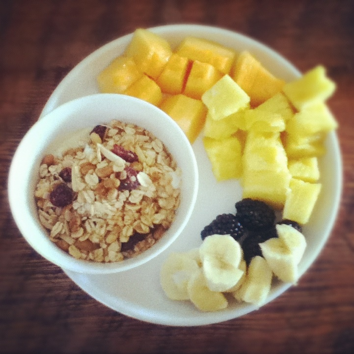 Post workout breakfast: plain Greek yogurt with agave nectar and homemade granola, 1/3 a banana, a few blackberries, some pineapple, and some more cantaloupe