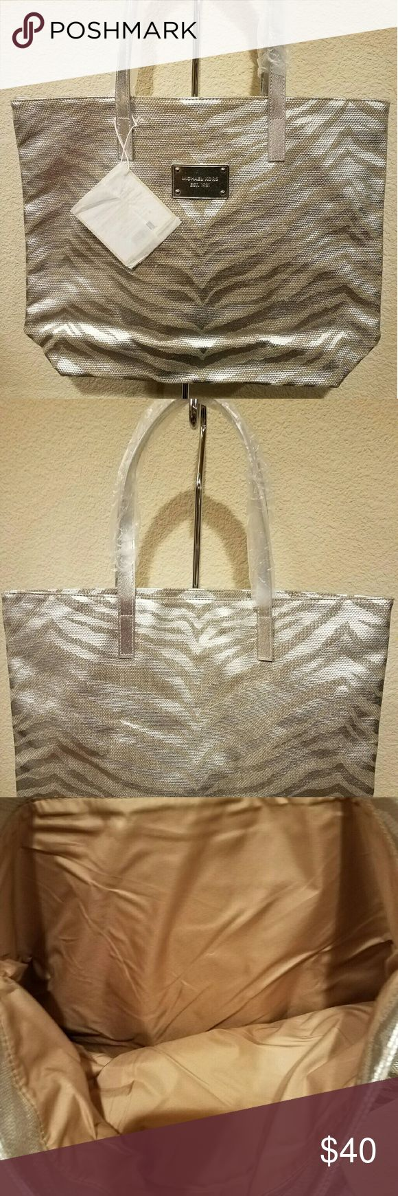 "Michael Kors Tote Silver and gold tiger print.  17""W x 13""H x 4""D Michael Kors Bags Totes"