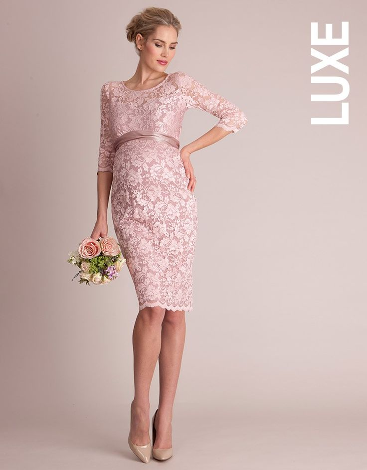 Unavailable sizes will be back in stock end of April.  Made in luxury stretch lace Keyhole button detailing at the back Silk sash  Made in luxury blush pink lace with a supreme level of stretch; this Lace Maternity Cocktail Dress has all the appearance of a fine, delicate style, with the added bonus of durability and a flexible fit for every stage of pregnancy! Feminine detailing defines this style, with a demure boat neckline and keyhole button ...