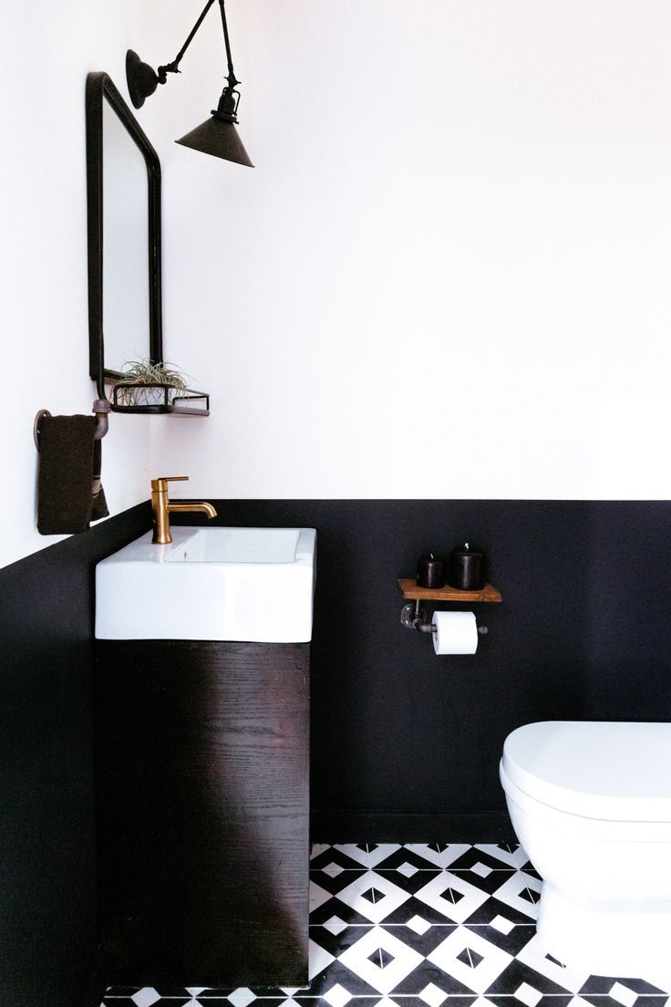 Interior Design by Noz Nozawa | Noz Design | This half-bathroom behind the kitchen of the concept co-living house in SOMA, San Francisco, has Cle Tile patterned cement tile floors, a painted black half-wall, and a mix of industrial and glam black/iron/gold fixtures and hardware.