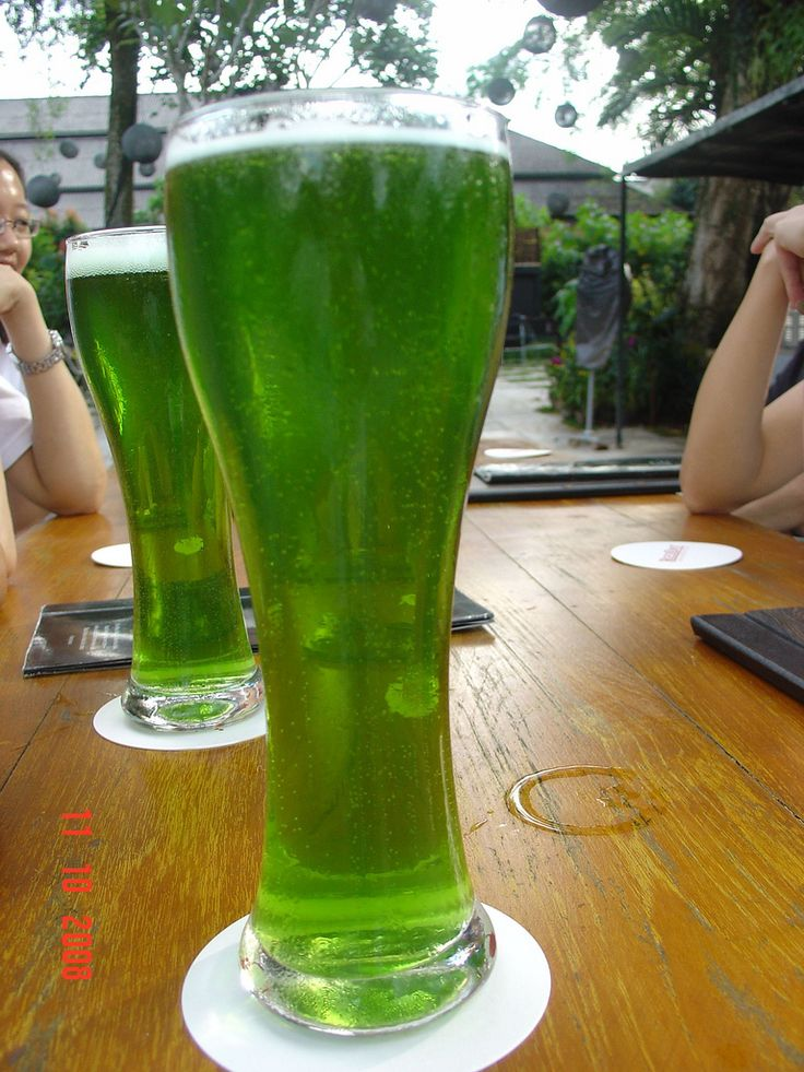 Green beer in pilsner glasses. photo by Eustaguio Santamano on Flickr