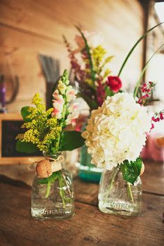 Whiskey or wine bottles as centrepieces or vases