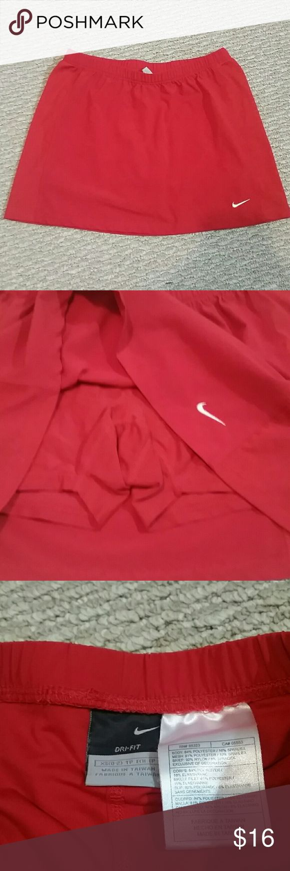 Nike red skort mesh size xs In excellent condition  No flaws  Mesh on the side and polyester  Size xs Nike skort tennis or badminton Nike Skirts Mini
