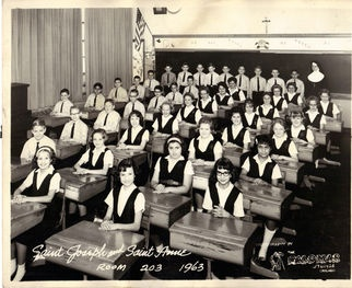 a well-orderd classroom-looks like my school back in the day, certainly the right time period!