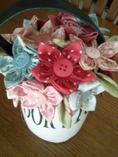 Add a few beautiful fabric flowers to a store bought door stop and look what happens!