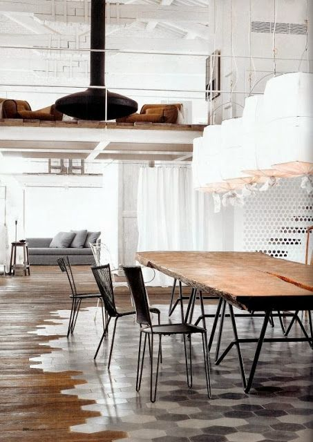 {Interior} Old factory converted to industrial home in Spello by Paola Navone | Rue du chat-qui-peche | Dining room | Hexagonal floor tiles