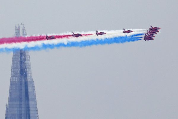 Members of the British Royal Air Force Aerobatic Team, the Red Arrows, fly in formation past The Shard skyscraper, as they perform a fly-past above Buckingham Place during the Queen's Birthday Parade, 'Trooping the Colour', in London on June 17, 2017....AFP PHOTO / Tolga AKMEN