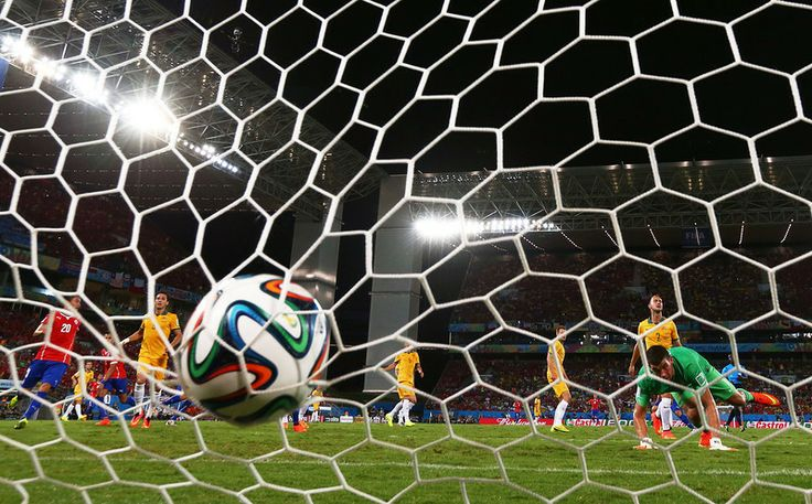 Description of . Jorge Valdivia of Chile (obscured) shoots and scores his teams second goal against goalkeeper Mathew Ryan of Australia during the 2014 FIFA World Cup Brazil Group B match between Chile and Australia at Arena Pantanal on June 13, 2014 in Cuiaba, Brazil.  (Photo by Matthew Lewis/Getty Images)