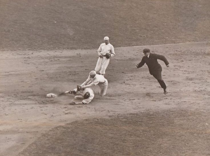 October 10, 1917 at the Polo Grounds: Game 3 of 1917 World Series, Buck Weaver of the White Sox is caught stealing as Giants SS Art Fletcher applies tag.