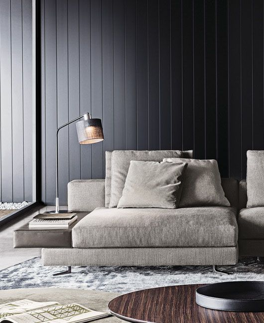 Black panelled wall, lounge seating, Minotti Kiddi Joy black lacquered table lamp