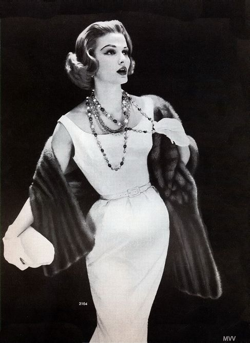 1950: I love the fur!!! This is so elegant, the white plan dress really let's the accessories shine.  The fur and the necklaces make this design really classy.