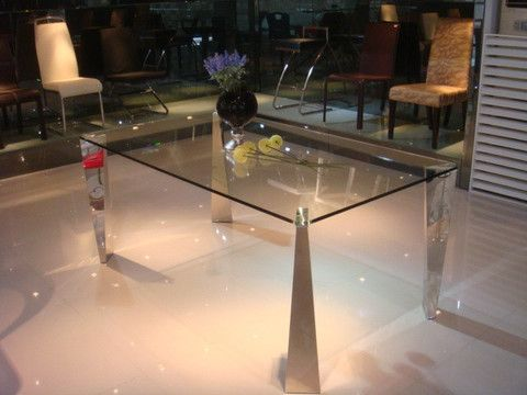"""The Pyramid Dining Table is a truly unique modern piece with its crystal clear top-quality glass attached to stunning chrome legs that alternate in a pyramid and inverted pyramid design.    Dimensions: 6' x 3'3"""" x 2'6"""" H"""
