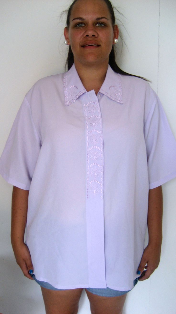 X-XL / 12-16 AU $25  L: 70cm B: 122cm   Lilac coloured vintage top with a full button up front with embroider front and neck feature...