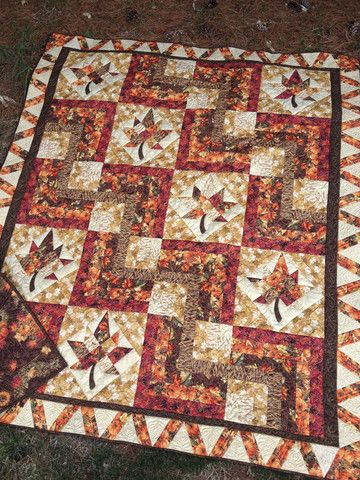 """68"""" x 80"""" Easy pieced blocks are nestled among maple leaves. A little appliqué and some template piecing are used to create this beauty. Sample uses Hoffman of California 'Maple Lane' line."""