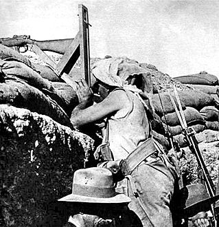 PERISCOPE RIFLE - (1915) rifle invented by Lance-Corporal W C Beech at Gallipoli. This device allowed a soldier standing in a trench to take accurate aim and fire without exposing himself to the enemy.