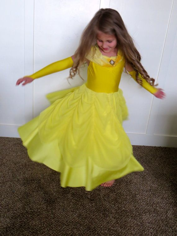 Beautiful Belle inspired dress is sure to please your little Princess! Made from soft and stretchy lycra and stretch mesh. Comes with matching glovettes. Machine washable too! Any Beast will fall madly in love with this precious Belle :) Dress is pictured with and without the tulle petticoat skirt (which is NOT included and sold separately.)  https://www.etsy.com/listing/190252038/sizes-2-78-tulle-petticoat-slip-to-wear?ref=shop_home_active_5  Sizing for Princess Dresses The size 2T measures…