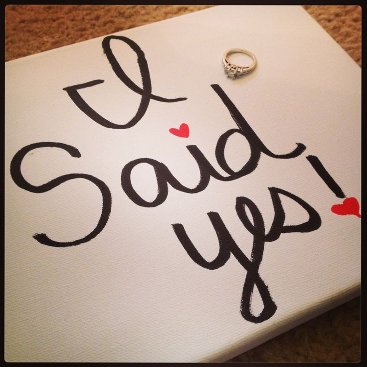 I said yes sign with my engagement ring. Easy to make, sharpie & canvas!