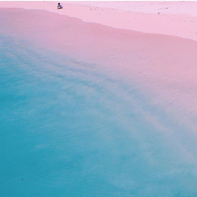 Pink Beach in Lombok, Indonesia. A white sand beach mixed with crushed pieces of pink coral