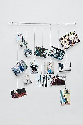 We call this the tangle photo frame, but it's not really a frame. Consisting of a bar and clip cables of varying lengths, this is a stylish and fresh way to display your favourite photos easily. THINGS TO KNOW:- Mixed metals- Holds up to 13 photographs- Requires screws (not included)