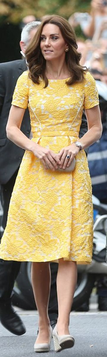 Who made  Kate Middleton's yellow dress, jewelry, nude wedge pumps, and clutch handbag?