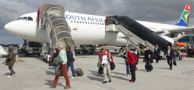 Disembarking from a SAA Airbus A340-200 in Cape Town