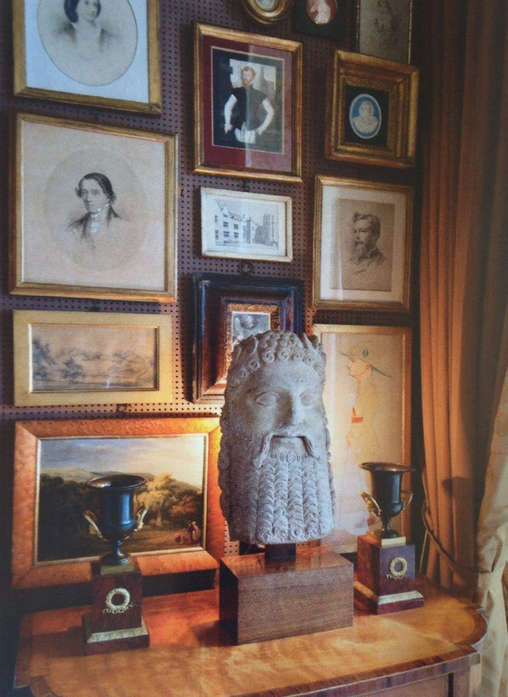 These - mostly Victorian - drawings and watercolors are hung on kitchen pegboard. World of Interiors, January 2014, Michael Inchbald's villa in Chelsea.