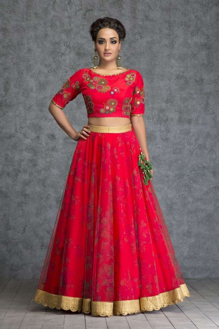 Being married or getting married is the best feeling in the world which comes with an added excitement of trousseau hunting. This knot stitched coin embroidered scarlet red silk crop top with printed tulle skirt is one of the most ultimate looks for the new bride. Add that extra radiance for your first 'karvachatuh'. - See more at: https://www.vemanya.com