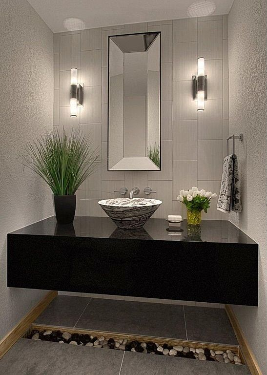 Modern Powder Room with simple granite tile floors, Powder room, Simple granite counters, Wall sconce, Vessel Sink