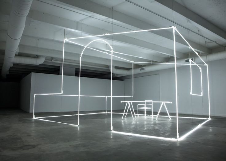 Italian artist Massimo Uberti has bent neon tubes into the shape of a room for an installation commissioned by British motor company Bentley.