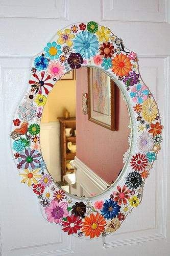 Mirror embellished with vintage enamel flower brooches