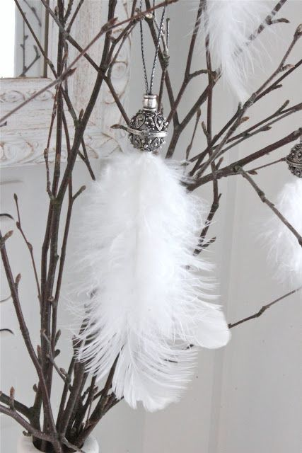 white ostrich feather tassel or could use this idea for peacock feathers