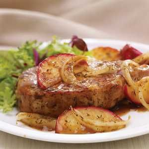 Apple and Sage Pork Chops Recipe - pork chops seasoned with sage and thyme, cooked with onion and apples simmered in sweet apple juice sauce.