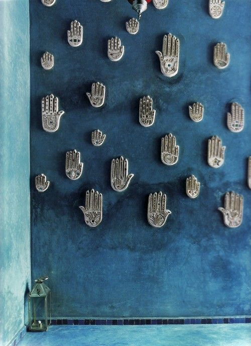 Fatima Hands art wall, Marakesh, daughter of muhammad, believed to bring good fortune, protect against evil spirits. Fingers represent five pillars of commitment to Islamic faith