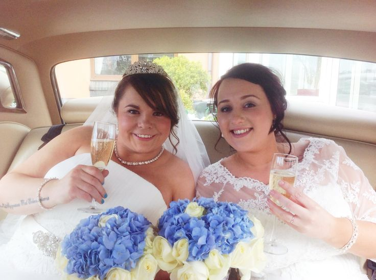 Relaxing after the ceremony in the luxury of a Rolls Royce . Available from www.goldchoiceweddingcars.co.uk