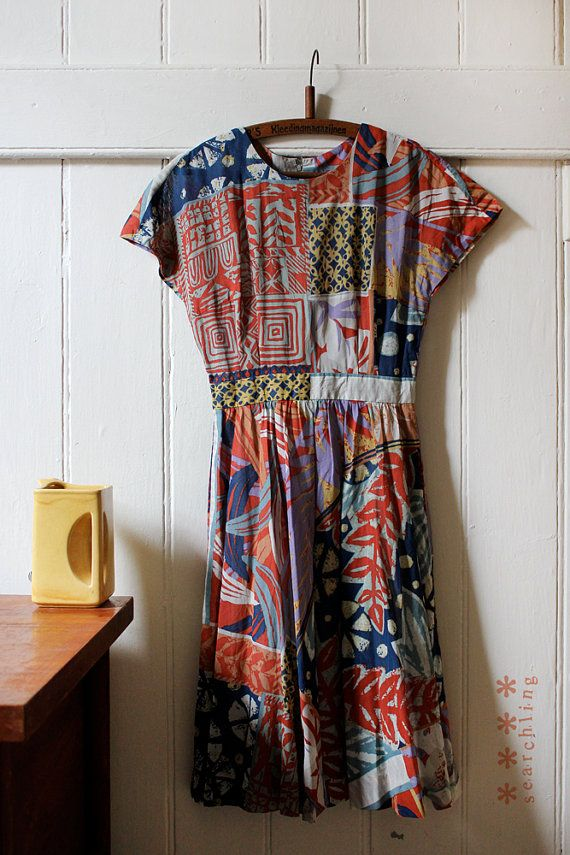 Vintage 1980s collage pattern dress featuring zip up back and hook and eye closure.  Made from soft cotton material.  In perfect condition.  Size small to medium  Measurements are in the final image
