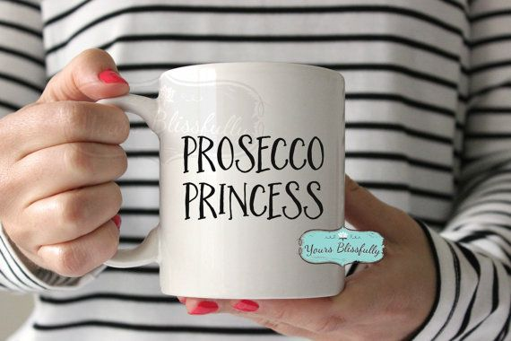 PROSECCO PRINCESS   Do you know a Prosecco Princess? Here is a Yours Blissfully white ceramic mug which features a fun quote and typography for the girl who loves Prosecco !  Fab fun Christmas present , Stocking Filler, or Secret Santa gift for the Prosecco Girl !  You can also personalise this with her name, simply select Personalised.  The quote is printed on both sides of the mug so it doesnt matter if you right handed or left handed you will always see it ! The ceramic mug is 10 oz mug…