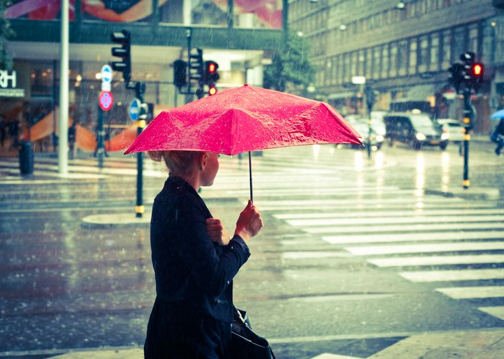 Under the red umbrella by Thomas Granbacka