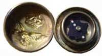 Compassipedia - The Online Compass Museum - WWII The most well-known escape compass as part of a uniform button.