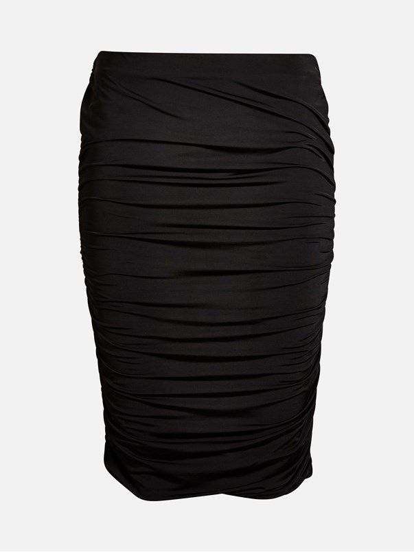 A narrow fit elastic skirt with gathered seam in the sides. Semi shiny fabric. The skirt is lined. Svart