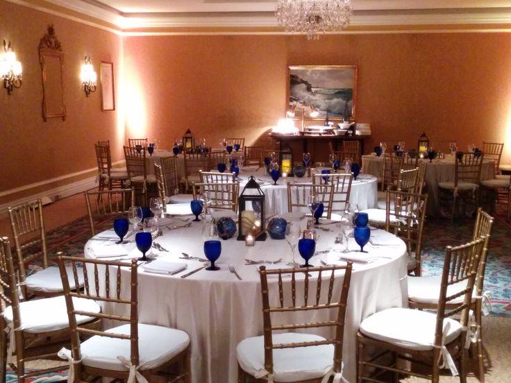 White Linen Blue Goblets Gold Chiavari Chairs Dinner Table Decor