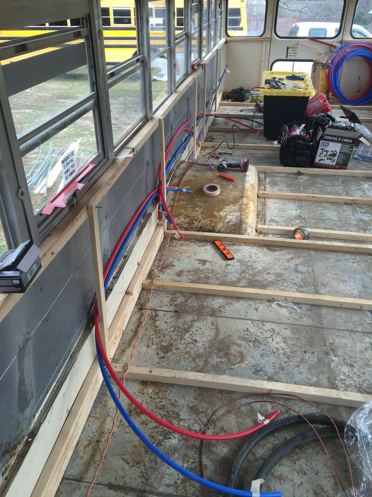 Roughing in the pex plumbing and electric  School Bus Tiny House Conversion  -Tristan Beache