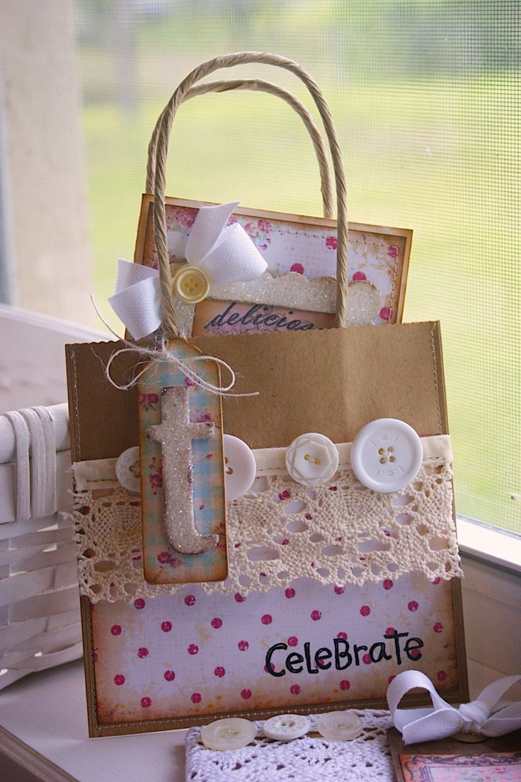 Ways to decorate gift bags - Cut a few inches off the top of a brown bag add handles ribbon