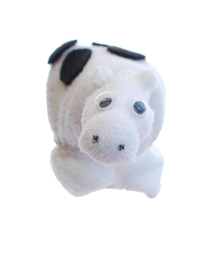 Baby washcloth cow made from two white baby washcloths. A perfect creation for a baby shower gift or to put on top of a farm nappy cake. Perfect for a baby boy gift, baby girl gift or unisex baby gift. Take a look at our farm nappy cakes.